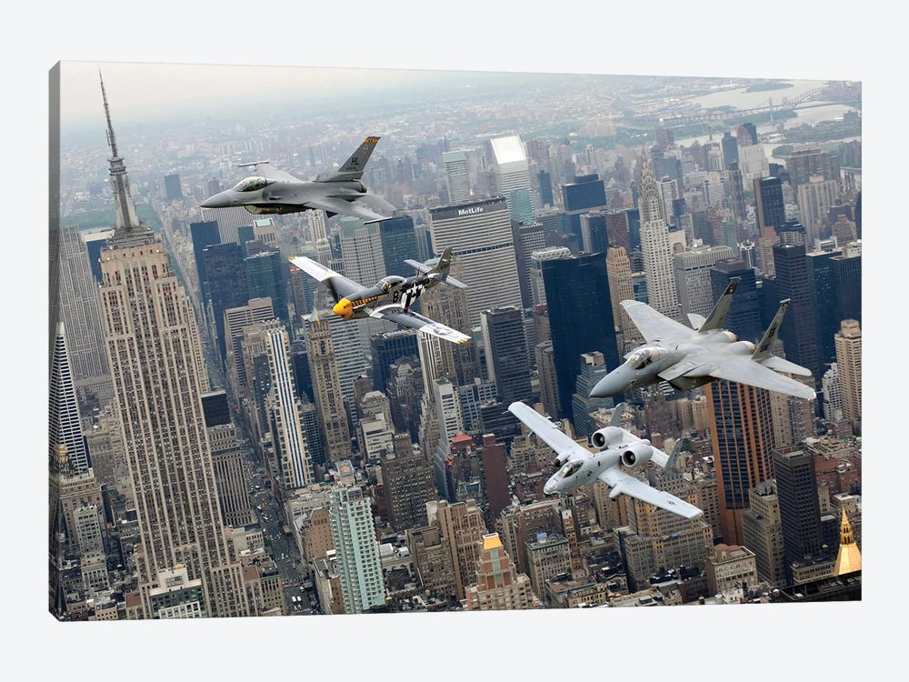 A P-51 Mustang, F-16 Fighting Falcon, F-15 Eagle, And A-10 Thunderbolt II Fly Over New York City by Stocktrek Images 1-piece Canvas Print