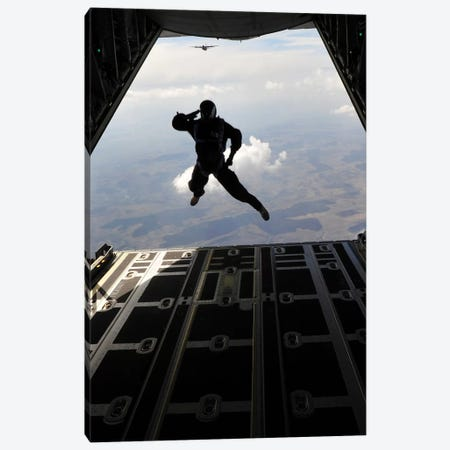 A Paratrooper Salutes As He Jumps Out Of A C-130J Super Hercules Canvas Print #TRK580} by Stocktrek Images Canvas Wall Art