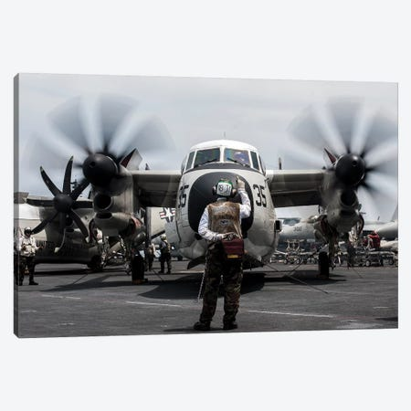 A Sailor Directs A C-2A Greyhound On The Flight Deck Of USS George Washington Canvas Print #TRK584} by Stocktrek Images Canvas Print