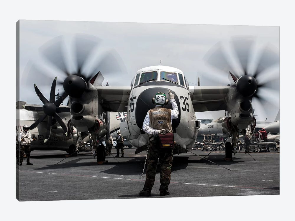 A Sailor Directs A C-2A Greyhound On The Flight Deck Of USS George Washington by Stocktrek Images 1-piece Canvas Art Print