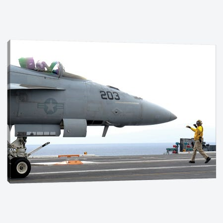 A Sailor Directs An F/A-18E Super Hornet Across The Flight Deck Of USS Nimitz Canvas Print #TRK585} by Stocktrek Images Canvas Print