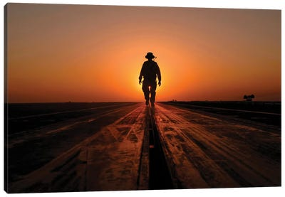 A Sailor Walks The Catapults On The Flight Deck Of USS Enterprise Canvas Art Print