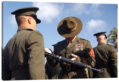A Senior Drill Instructor Inspects A Recruit's Rifle For Cleanliness Canvas Art Print