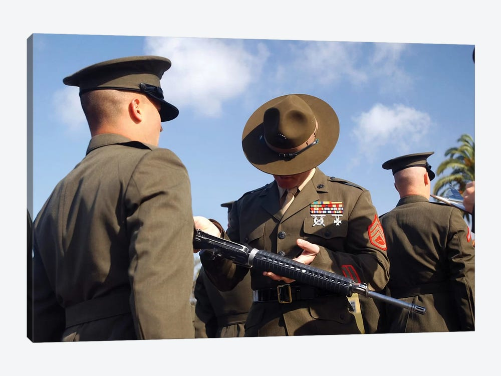 A Senior Drill Instructor Inspects A Recruit's Rifle For Cleanliness by Stocktrek Images 1-piece Canvas Art Print