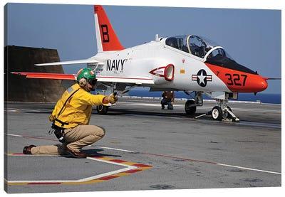 A Shooter Signals The Launch Of A T-45A Goshawk Trainer Aircraft Canvas Art Print