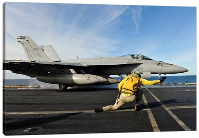 A Shooter Signals To Launch An F/A-18E Super Hornet Aboard USS Nimitz Canvas Art Print