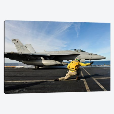 A Shooter Signals To Launch An F/A-18E Super Hornet Aboard USS Nimitz Canvas Print #TRK591} by Stocktrek Images Art Print