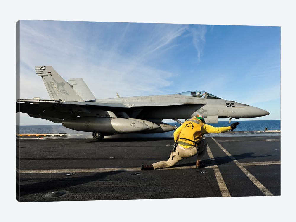 A Shooter Signals To Launch An F/A-18E Super Hornet Aboard USS Nimitz by Stocktrek Images 1-piece Canvas Print