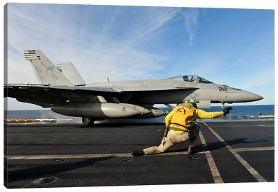 A Shooter Signals To Launch An F/A-18E Super Hornet Aboard USS Nimitz Canvas Art Print