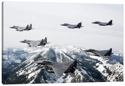 A Six-Ship Formation Of Aircraft Fly Over The Sawtooth Mountains In Idaho Canvas Art Print