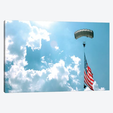 A Skydiver Carries A US Flag While Descending Through The Sky Canvas Print #TRK596} by Stocktrek Images Canvas Artwork
