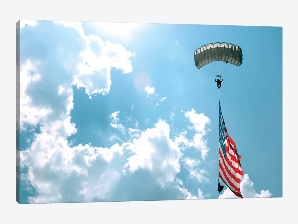 A Skydiver Carries A US Flag While Descending Through The Sky 1-piece Canvas Wall Art
