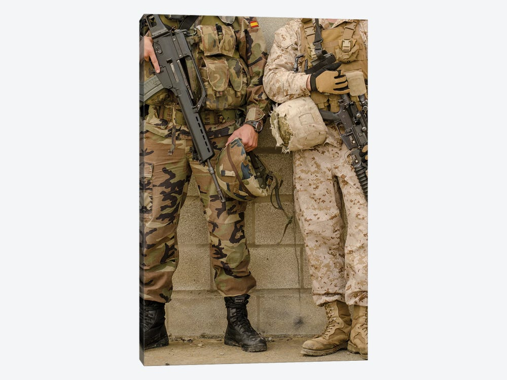 A Spanish Marine And A US Marine Relax Against A Wall by Stocktrek Images 1-piece Art Print
