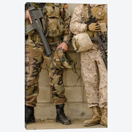 A Spanish Marine And A US Marine Relax Against A Wall Canvas Print #TRK600} by Stocktrek Images Art Print