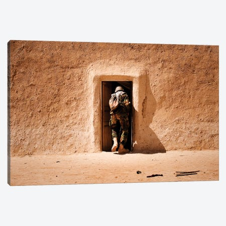 A Squad Leader Searches The Room Of A Compound In Afghanistan Canvas Print #TRK602} by Stocktrek Images Canvas Print