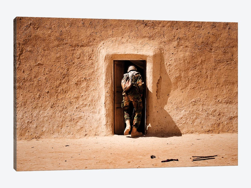 A Squad Leader Searches The Room Of A Compound In Afghanistan by Stocktrek Images 1-piece Canvas Art Print