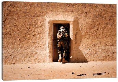 A Squad Leader Searches The Room Of A Compound In Afghanistan Canvas Art Print