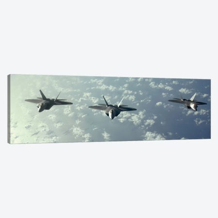 A Three-Ship Formation Of F-22 Raptors Fly Over The Pacific Ocean Canvas Print #TRK610} by Stocktrek Images Canvas Artwork