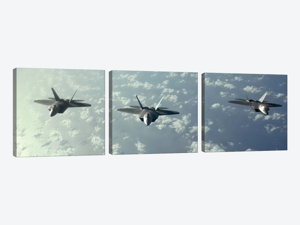 A Three-Ship Formation Of F-22 Raptors Fly Over The Pacific Ocean by Stocktrek Images 3-piece Canvas Wall Art