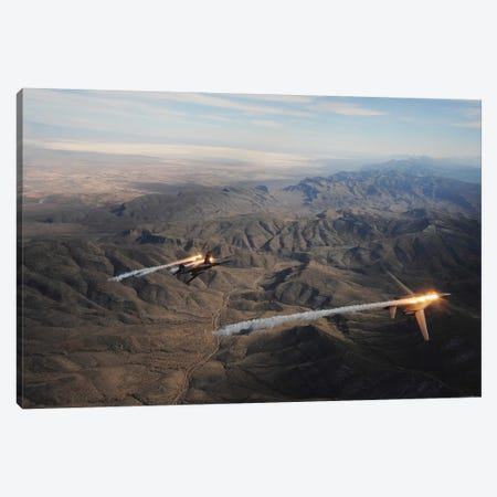 A Two-Ship Of B-1B Lancers Release Chaff And Flares While Maneuvering Over New Mexico Canvas Print #TRK612} by Stocktrek Images Canvas Art