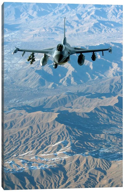 A US Air Force F-16C Fighting Falcon In Flight Over Afghanistan Canvas Art Print
