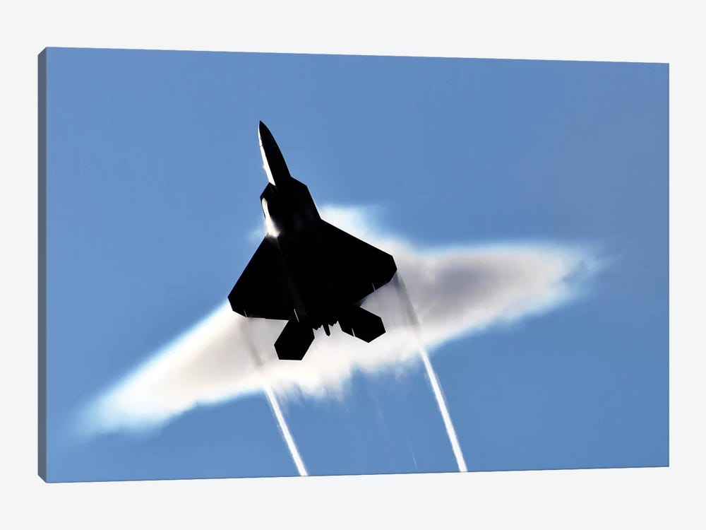 A US Air Force F-22 Raptor Aircraft Executing A Supersonic Flyby by Stocktrek Images 1-piece Canvas Artwork