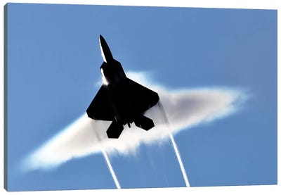 A US Air Force F-22 Raptor Aircraft Executing A Supersonic Flyby Canvas Art Print