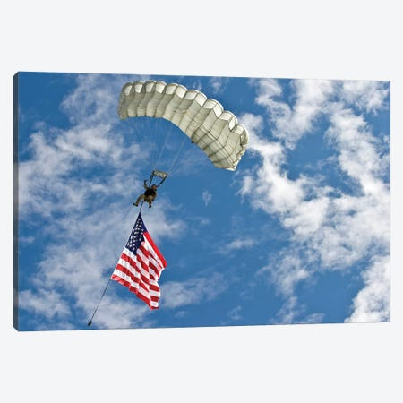 A US Air Force Member Glides Through The Sky With The American Flag Canvas Print #TRK624} by Stocktrek Images Canvas Art
