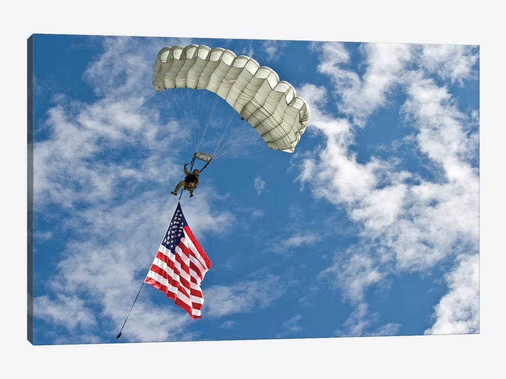 A US Air Force Member Glides Through The Sky With The American Flag 1-piece Canvas Art Print