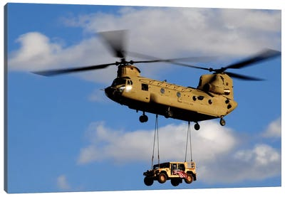 A US Army CH-47 Chinook Helicopter Transports A Humvee Canvas Art Print