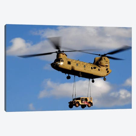 A US Army CH-47 Chinook Helicopter Transports A Humvee Canvas Print #TRK628} by Stocktrek Images Canvas Art Print