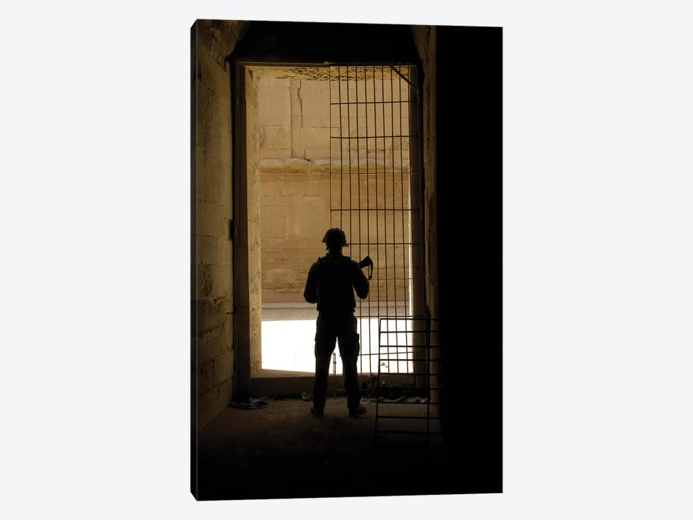 A US Army Soldier Checking Out The Al Hadr Ruins In Al Hadr, Iraq by Stocktrek Images 1-piece Canvas Art