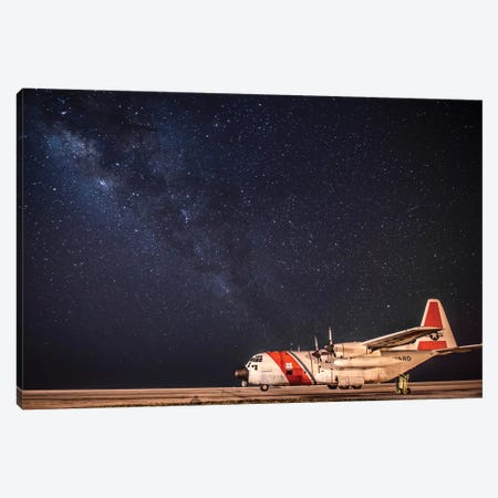 A US Coast Guard C-130 Hercules Parked On The Tarmac On A Starry Night Canvas Print #TRK632} by Stocktrek Images Canvas Artwork