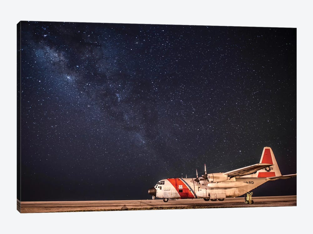 A US Coast Guard C-130 Hercules Parked On The Tarmac On A Starry Night by Stocktrek Images 1-piece Canvas Wall Art