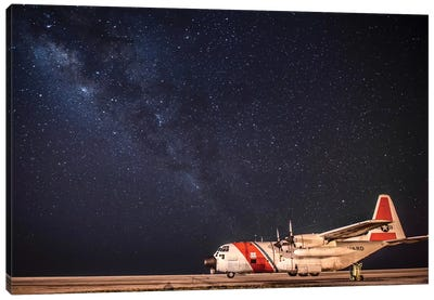 A US Coast Guard C-130 Hercules Parked On The Tarmac On A Starry Night Canvas Art Print