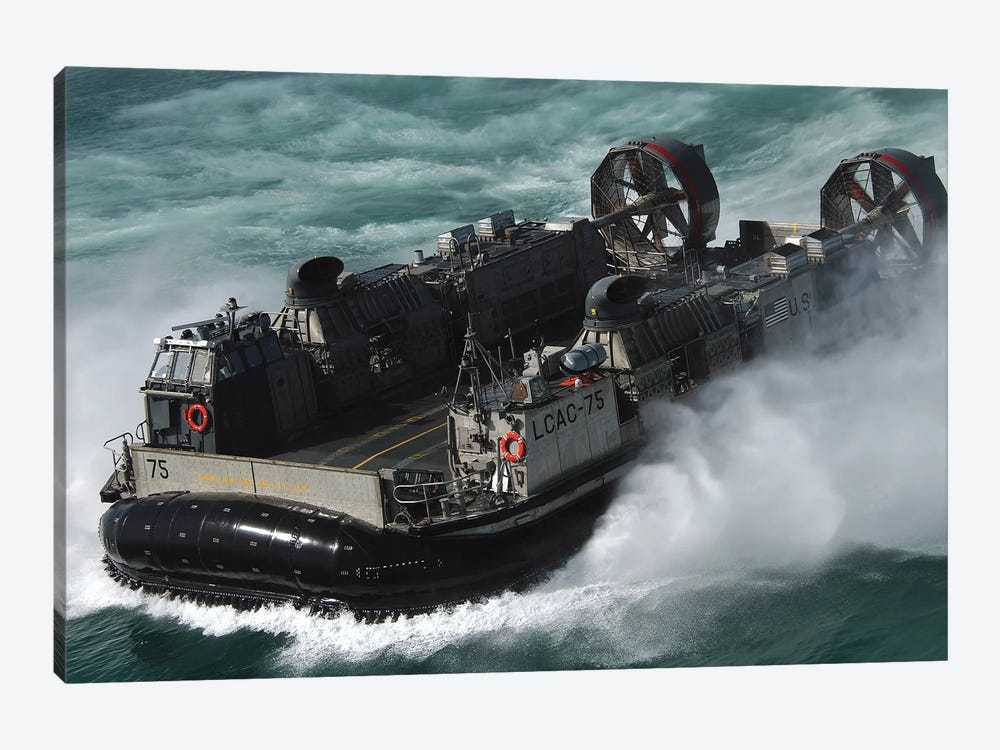 A US Navy Landing Craft Air Cushion Heading To The Kuwait Naval Base by Stocktrek Images 1-piece Canvas Print