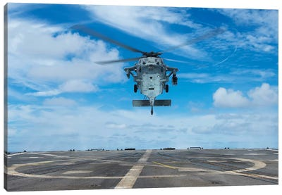 A US Navy MH-60S Seahawk Helicopter Prepares To Land Canvas Art Print