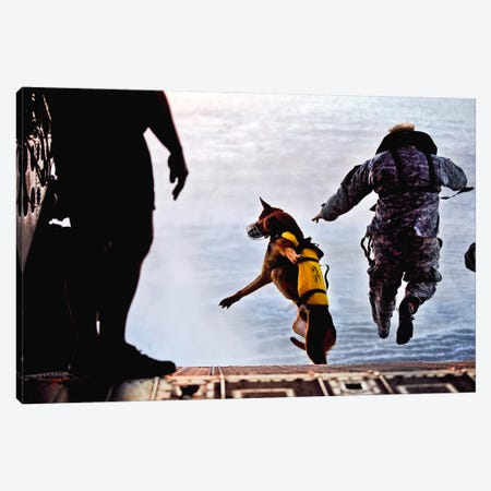 A US Soldier And His Military Working Dog Jump Off The Ramp Of A CH-47 Chinook Canvas Print #TRK642} by Stocktrek Images Canvas Art Print