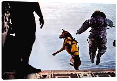 A US Soldier And His Military Working Dog Jump Off The Ramp Of A CH-47 Chinook Canvas Art Print