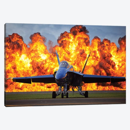 A Wall Of Fire Erupts Behind A US Navy F/A-18 Hornet Aircraft Canvas Print #TRK647} by Stocktrek Images Canvas Artwork