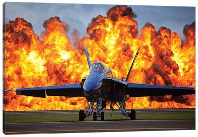 A Wall Of Fire Erupts Behind A US Navy F/A-18 Hornet Aircraft Canvas Art Print