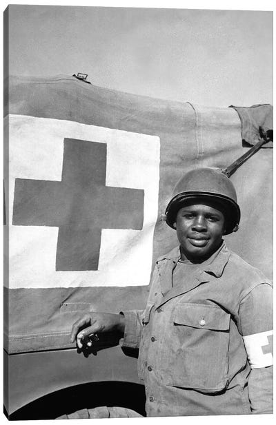A WWII Soldier Stands Next To His Red Cross Vehicle Canvas Art Print