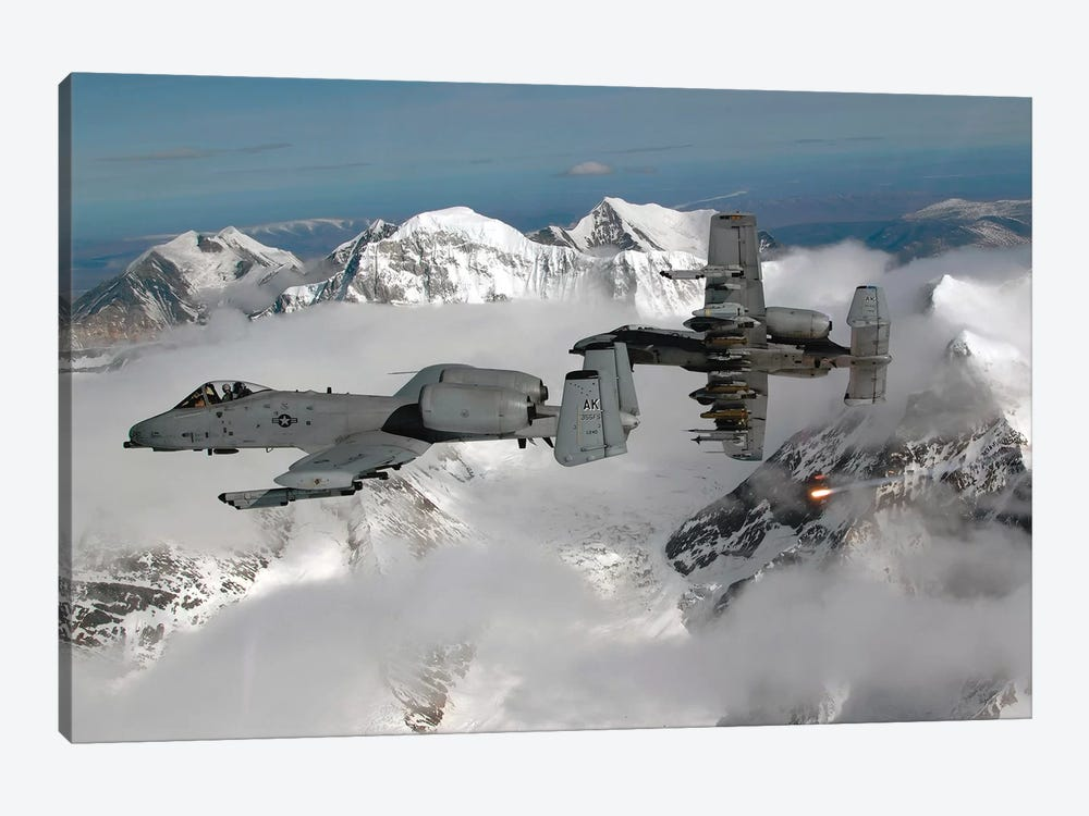 A-10 Thunderbolt IIs Fly Over Mountainous Landscape by Stocktrek Images 1-piece Canvas Art