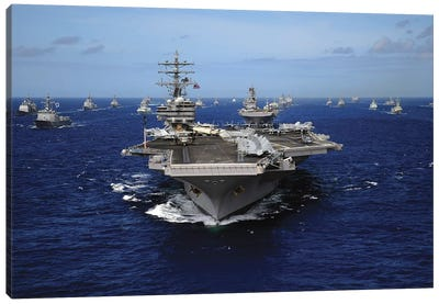 Aircraft Carrier USS Ronald Reagan Leads A Mass Formation Of Ships Through The Pacific Ocean Canvas Art Print