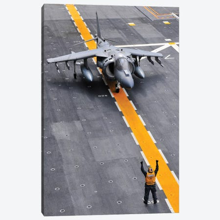 Airman Directs An AV-8B Harrier II Aircraft On The Flight Deck Of USS Peleliu Canvas Print #TRK664} by Stocktrek Images Canvas Wall Art