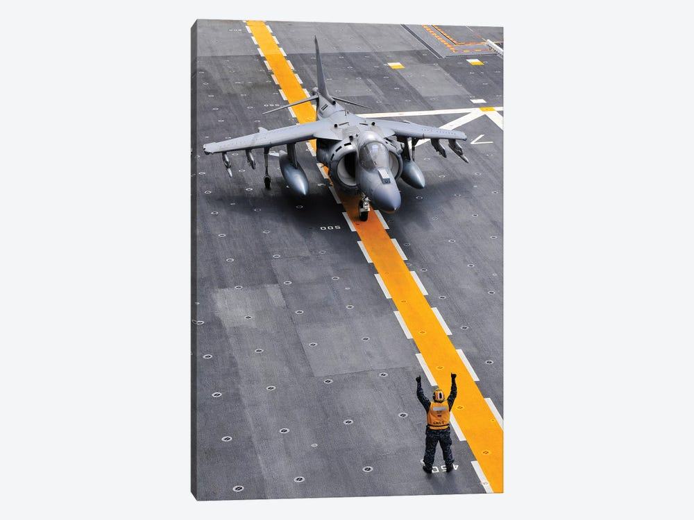 Airman Directs An AV-8B Harrier II Aircraft On The Flight Deck Of USS Peleliu by Stocktrek Images 1-piece Canvas Print