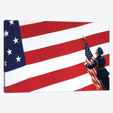 Airman Posts The American Flag During A Change Of Command Ceremony Canvas Print #TRK666} by Stocktrek Images Canvas Wall Art