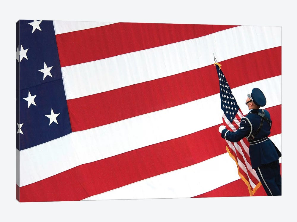 Airman Posts The American Flag During A Change Of Command Ceremony by Stocktrek Images 1-piece Canvas Art Print