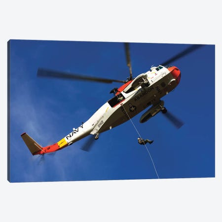 Airman Practices Rappelling Out Of A UH-3H Helicopter Canvas Print #TRK667} by Stocktrek Images Canvas Artwork