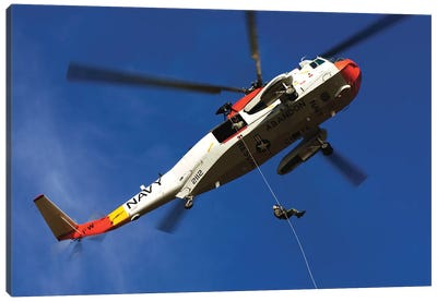 Airman Practices Rappelling Out Of A UH-3H Helicopter Canvas Art Print